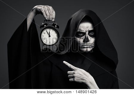 Scary Death Hold A Watch In His Hand. Realistic Skull Makeup.
