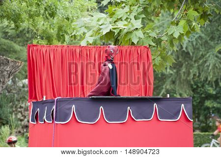 Performance of puppets in Retiro Park, Madrid, Spain