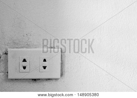 Old Electrical Outlet On A Wall