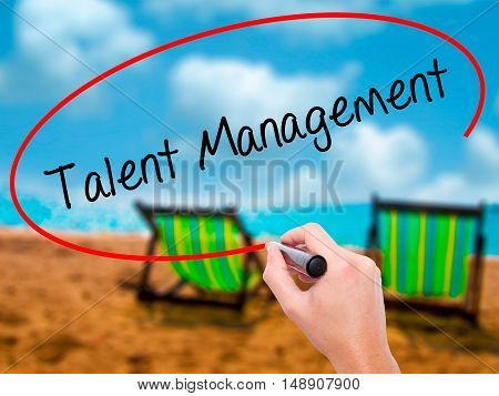 Man Hand Writing Talent Management With Black Marker On Visual Screen