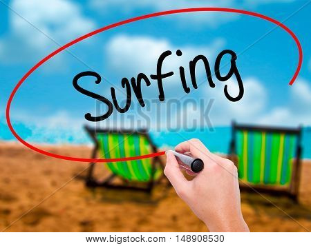 Man Hand Writing Surfing  With Black Marker On Visual Screen