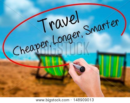 Man Hand Writing Travel Cheaper Longer Smarter  With Black Marker On Visual Screen