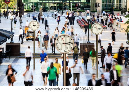 London UK - August 30 2016 - Business people walking in motion in Canary Wharf