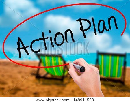 Man Hand Writing Action Plan With Black Marker On Visual Screen