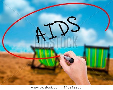 Man Hand Writing Aids With Black Marker On Visual Screen