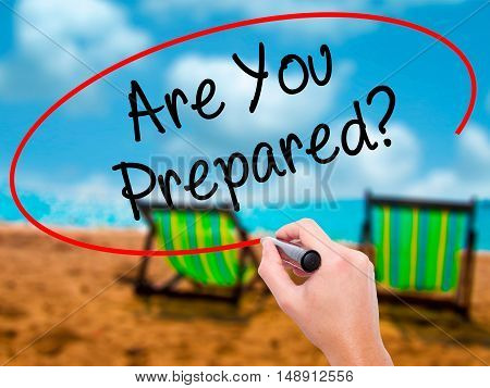 Man Hand Writing Are You Prepared? With Black Marker On Visual Screen.
