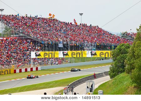 Racing cars on a circuit during The Formula 1 Grand Prix
