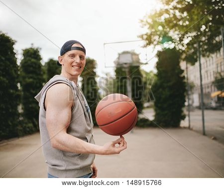 Teenage Streetball Player Spinning The Ball