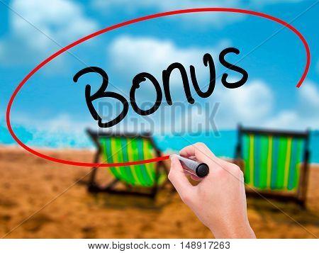 Man Hand Writing Bonus With Black Marker On Visual Screen