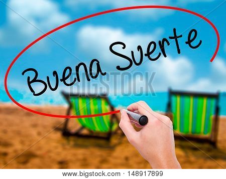 Man Hand Writing Buena Suerte( Good Luck In Spanish) With Black Marker On Visual Screen