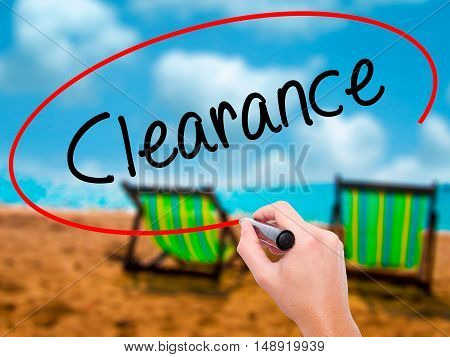Man Hand Writing Clearance  With Black Marker On Visual Screen