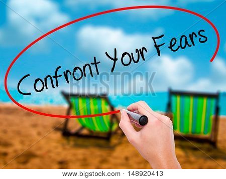 Man Hand Writing Confront Your Fears With Black Marker On Visual Screen
