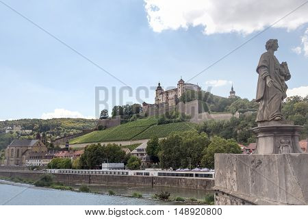 The fortress rises visible from afar at the height of the Marienberg about the city of Wuerzburg