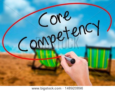 Man Hand Writing Core Competency With Black Marker On Visual Screen