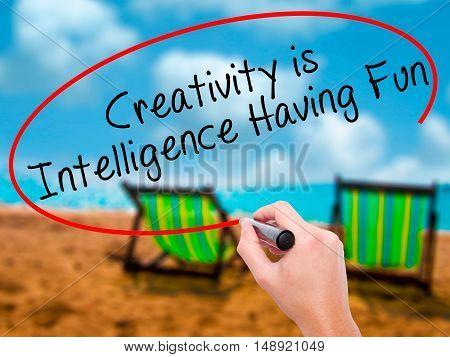 Man Hand Writing Creativity Is Intelligence Having Fun With Black Marker On Visual Screen