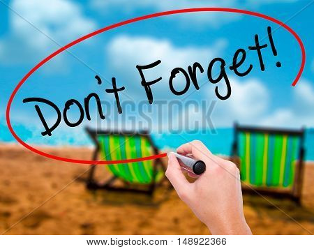 Man Hand Writing Don't Forget!  With Black Marker On Visual Screen