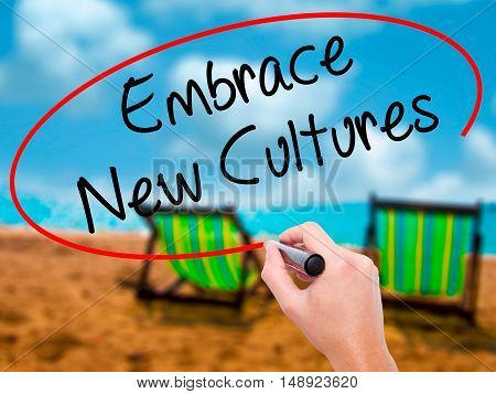 Man Hand Writing Embrace New Cultures With Black Marker On Visual Screen