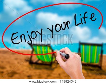 Man Hand Writing Enjoy Your Life With Black Marker On Visual Screen