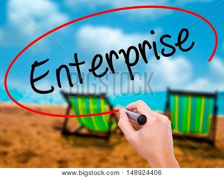 Man Hand Writing Enterprise With Black Marker On Visual Screen