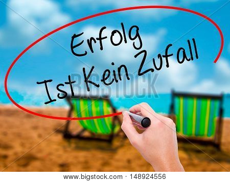 Man Hand Writing Erfolg Ist Kein Zaufall (success Is No Accident In German) With Black Marker On Vis