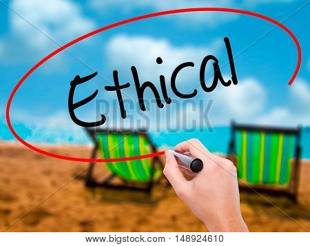 Man Hand Writing Ethical  With Black Marker On Visual Screen