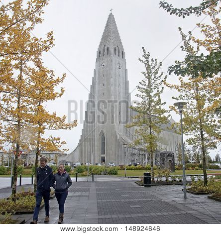 REYKJAVIK ICELAND - SEPTEMBER 15 2016: Tourists visiting landmarks in the Hallgr