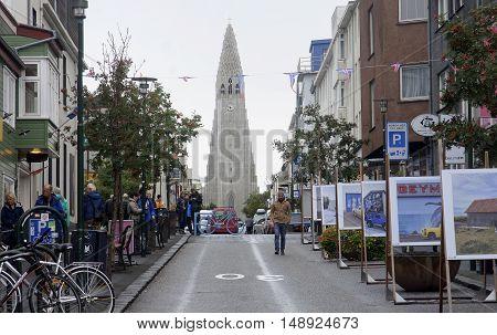 REYKJAVIK ICELAND - SEPTEMBER 15 2016: Tourists visiting landmarks in the Hallgr