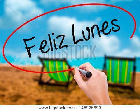 Man Hand Writing Feliz Lunes (happy Monday In Spanish) With Black Marker On Visual Screen