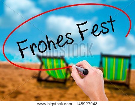 Man Hand Writing Frohes Fest  (happy Christmas In German) With Black Marker On Visual Screen