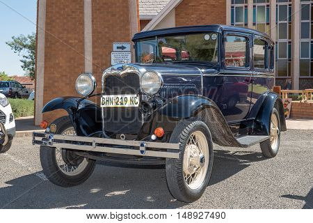 KIMBERLEY SOUTH AFRICA - SEPTEMBER 24 2016: A public display of new and vintage cars at a fair at the Dutch Reformed Church Vooruitsig in Kimberley