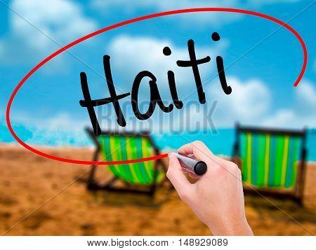 Man Hand Writing Haiti With Black Marker On Visual Screen