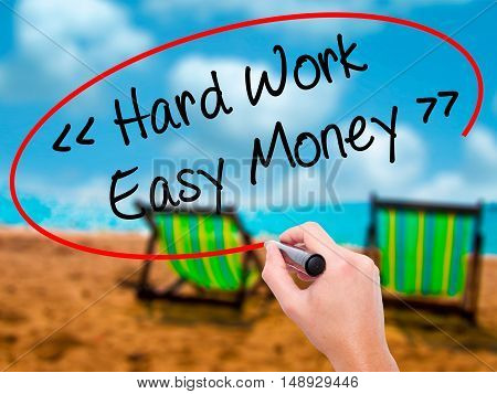Man Hand Writing Hard Work - Easy Money With Black Marker On Visual Screen.
