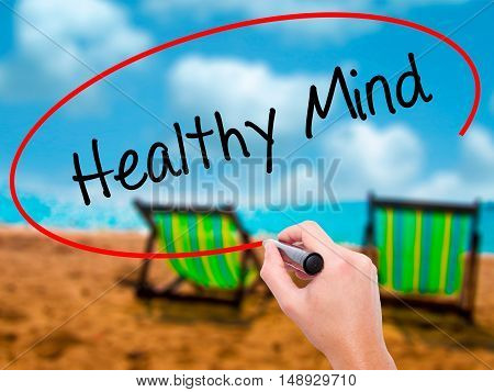 Man Hand Writing Healthy Mind With Black Marker On Visual Screen