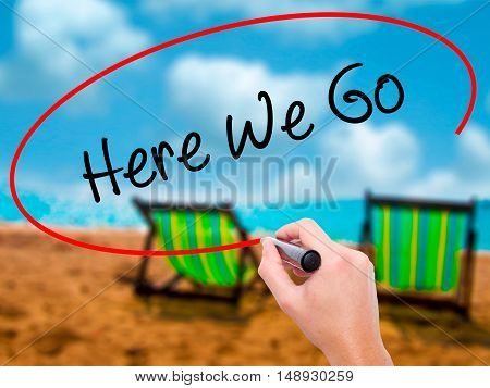 Man Hand Writing Here We Go With Black Marker On Visual Screen