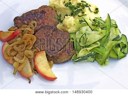 fried turkey liver with sauted onions and apple slices, mashed potatoes and zucchini-noodles