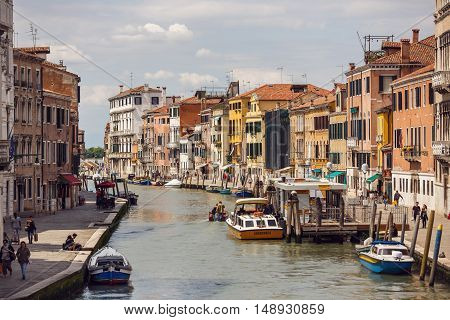 Venice Italy - May 05 2016: The tourist boats in the canals of Venice in spring time