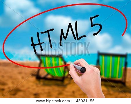 Man Hand Writing Html 5 With Black Marker On Visual Screen
