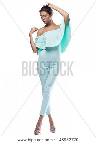 Portrait in full growth of a beautiful young woman in turquoise tight clothes, isolated on white background
