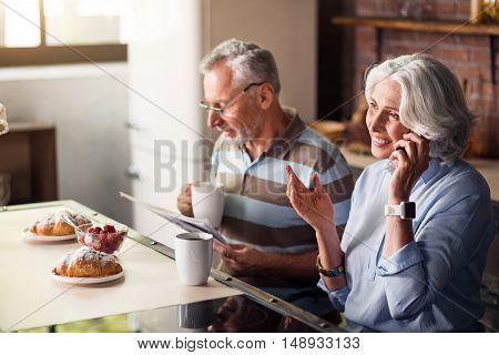 Daily life. Happy elderly couple having their regular calm morning routine