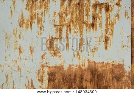 Rusty steel garage door. Strips of rusting as the strokes of paint on a gray metal background