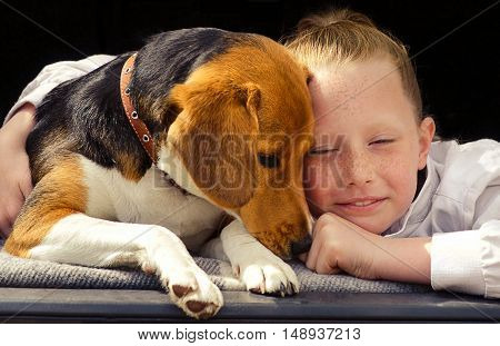 Happy Little Girl And Beagle Puppy