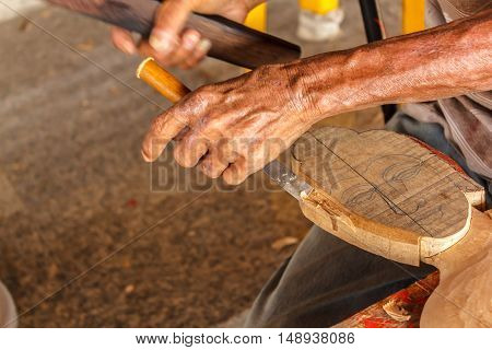 hands of the craftsman carve and tools of the wood carver poster