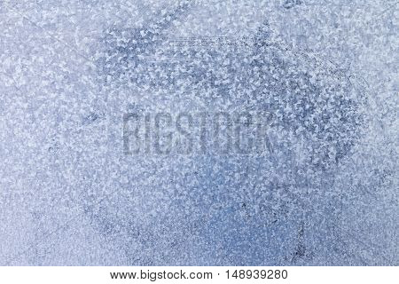 Background texture of a sheet of galvanised metal coated with a layer of zinc to prevent corrosion and rust