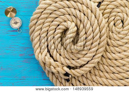 Two Neatly Coiled Ropes And A Magnetic Compass