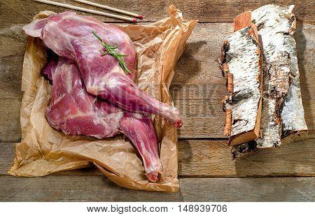 Raw Lamb Shank  On  Rustic Wooden Board.