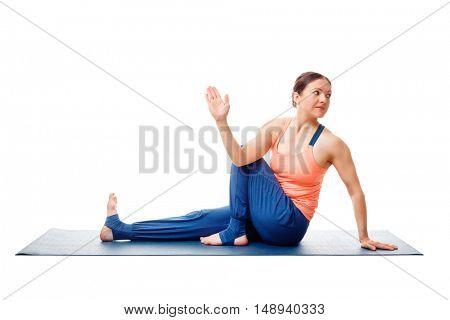 Woman doing yoga asana Ardha matsyendrasana - half spinal twist pose posture isolated on white background