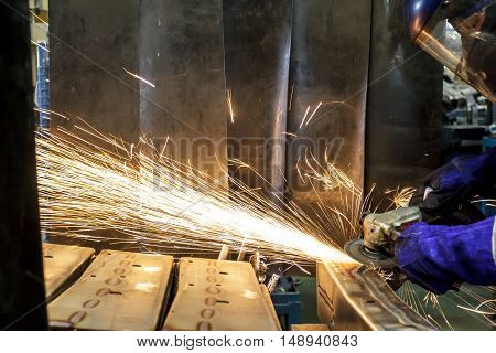 Electric spark grinding wheels with steel automobile parts built in factories focus motion blur