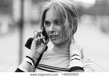 Student talking on phone at street , black and white photo