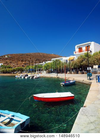 FAROS SIFNOS GREECE-SEPT. 15: The small port harbor of Faros Sifnos Island Greece with fishing boats taverna restaurant and rooms for rent is seen on September 15 2016.