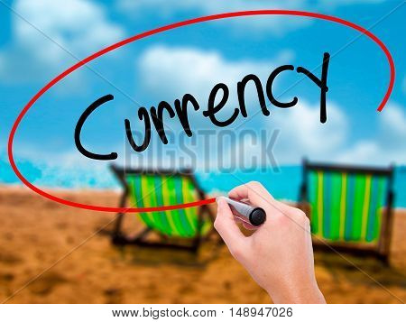Man Hand Writing Currency With Black Marker On Visual Screen